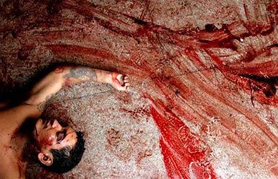 图文:危地马拉监狱冲突中丧生者的尸体